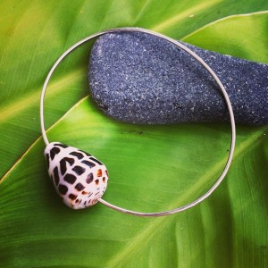 silver bangle bracelet with a cone shell